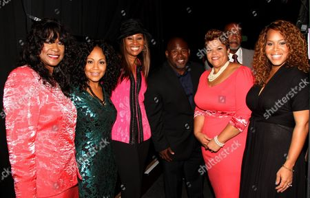 "L-R) Gospel singers Jackie Gouche, Erica Atkins-Campbell, Yolanda Adams, actor David Mann, Tamela Mann and Trecina ""Tina"" Atkins-Campbell backstage at LA Focus 15th Annual First Ladies High Tea at Beverly Hilton Hotel, in Bevrly Hills, California"