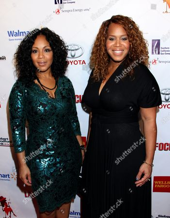 """Honorees Erica Atkins-Campbell and Trecina """"Tina"""" Atkins-Campbel of Gospel duo Mary Mary arrive at LA Focus 15th Annual First Ladies High Tea at Beverly Hilton Hotel, in Bevrly Hills, California"""