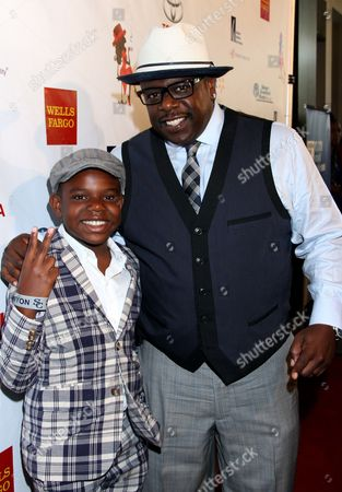 Actor, Comedian, Host Cedric the Entertainer and his son Croix Kyles arrive at LA Focus 15th Annual First Ladies High Tea at Beverly Hilton Hotel, in Bevrly Hills, California