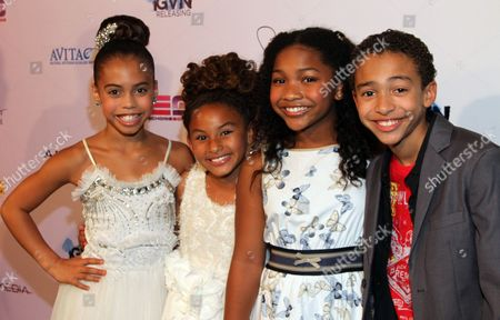 """Stock Photo of Young actors (from left) Asia Monet Ray, Sade Kimora Young, Laya DeLeon Hayes and Jaden Betts seen at LA Premiere of """"Sister Code"""" at Universal Theaters AMC, in Universal City, California"""