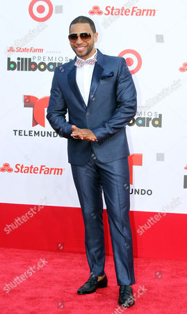Dominican singer Henry Santos arrives at the Latin Billboard Awards in Coral Gables, Fla