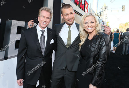"""Screenwriter Creighton Rothenberger, Glen Powell and Screenwriter Katrin Benedikt arrive at the Lionsgate Los Angeles premiere of """"The Expendables 3"""" at TCL Chinese Theatre, in Hollywood, Calif"""