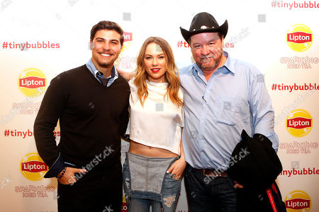 Actor Luke Bilyk, and actress Chloe Rose with director Bruce McDonald on the red carpet at the Lipton Sparkling Iced Tea Lounge in Park City, Utah, on