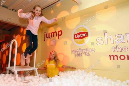 Avery Phillips jumps into the ball pit at the Lipton Sparkling Iced Tea Lounge in Park City, Utah