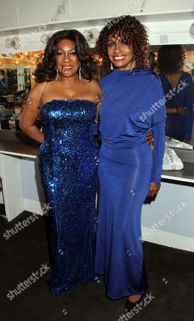 Stock Photo of R&B legend Mary Wilson and actress Beverly Todd backstage at Mary Wilson Original Supreme Children Uniting Nations Benefit Concert on Sunday, December, 16, 2012, at Saban Theatre in Beverly Hills, California