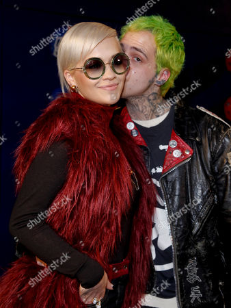 Rita Ora, left, and Richard Hilfiger attend the Tommy Hilfiger Fall 2015 show during Mercedes-Benz Fashion Week Fall 2015 at The Park Avenue Armory, in New York