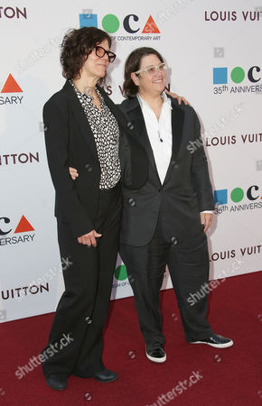 Julie Burleigh, left, and Catherine Opie arrive at MOCA's 35th Anniversary Gala presented by Louis Vuitton at The Geffen Contemporary at MOCA on in Los Angeles