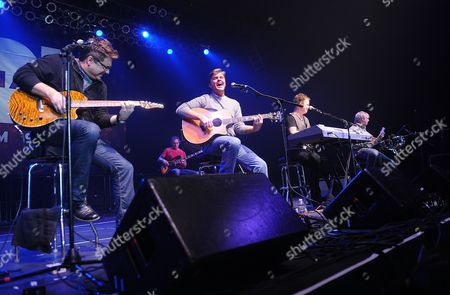 Country Musician Michael Britt, Richie McDonald, Dean Sams, and Keech Rainwater of the music group Lonestar perform on stage at the NASH FM 94.7 Country Music Concert Night 1 at Roseland Ballroom on in New York