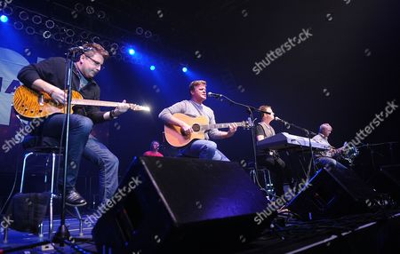 Stock Photo of Country Musician Michael Britt, Richie McDonald, Dean Sams, and Keech Rainwater of the music group Lonestar perform on stage at the NASH FM 94.7 Country Music Concert Night 1 at Roseland Ballroom on in New York