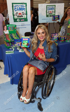 TV personality Tiphany Adams supports the #LetsGetHerToCamp campaign with Nestle Crunch Girl Scout Candy Bars at an Emmy Awards gift suite on in Los Angeles. To help send girls to Girl Scout camp visit NestleCrunch.com/LetsGetHerToCamp by August 31