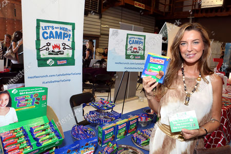 Actress Sandra Vidal supports the #LetsGetHerToCamp campaign with Nestle Crunch Girl Scout Candy Bars at an Emmy Awards gift suite on in Los Angeles. To help send girls to Girl Scout camp visit NestleCrunch.com/LetsGetHerToCamp by August 31