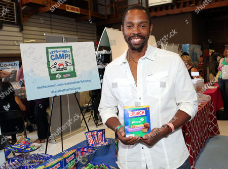 Stock Photo of Actor Treva Etienne supports the #LetsGetHerToCamp campaign with Nestle Crunch Girl Scout Candy Bars at an Emmy Awards gift suite on in Los Angeles. To help send girls to Girl Scout camp visit NestleCrunch.com/LetsGetHerToCamp by August 31