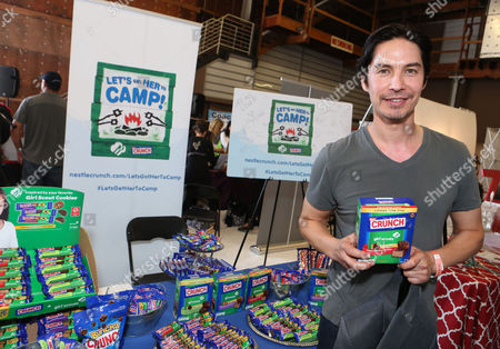 Actor Michael Teh supports the #LetsGetHerToCamp campaign with Nestle Crunch Girl Scout Candy Bars at an Emmy Awards gift suite on in Los Angeles. To help send girls to Girl Scout camp visit NestleCrunch.com/LetsGetHerToCamp by August 31