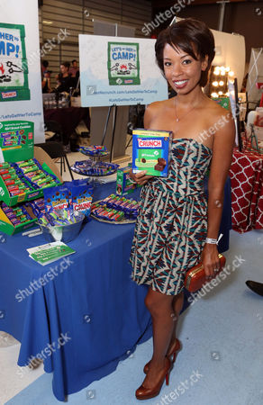 Actress Toks Olagundoye supports the #LetsGetHerToCamp campaign with Nestle Crunch Girl Scout Candy Bars at an Emmy Awards gift suite on in Los Angeles. To help send girls to Girl Scout camp visit NestleCrunch.com/LetsGetHerToCamp by August 31