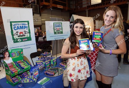 Actress Daniela Bobadilla, left, supports the #LetsGetHerToCamp campaign with Nestle Crunch Girl Scout Candy Bars at an Emmy Awards gift suite on in Los Angeles. To help send girls to Girl Scout camp visit NestleCrunch.com/LetsGetHerToCamp by August 31