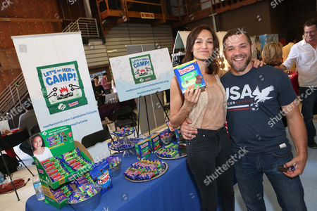 Actress Nicole da Silva, left, supports the #LetsGetHerToCamp campaign with Nestle Crunch Girl Scout Candy Bars at an Emmy Awards gift suite on in Los Angeles. To help send girls to Girl Scout camp visit NestleCrunch.com/LetsGetHerToCamp by August 31