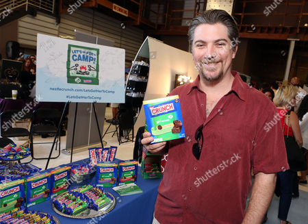 Actor Jeremy Miller supports the #LetsGetHerToCamp campaign with Nestle Crunch Girl Scout Candy Bars at an Emmy Awards gift suite on in Los Angeles. To help send girls to Girl Scout camp visit NestleCrunch.com/LetsGetHerToCamp by August 31