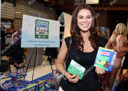 Actress Jennifer Taylor supports the #LetsGetHerToCamp campaign with Nestle Crunch Girl Scout Candy Bars at an Emmy Awards gift suite on in Los Angeles. To help send girls to Girl Scout camp visit NestleCrunch.com/LetsGetHerToCamp by August 31