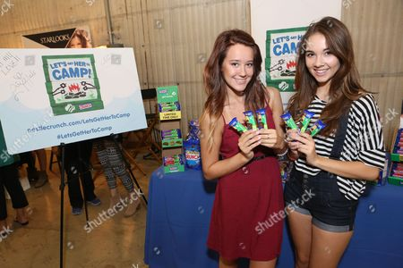 Actress Haley Pullos, right, supports the #LetsGetHerToCamp campaign with Nestl? Crunch Girl Scout Candy Bars at a Teen Choice Awards gift suite on in Los Angeles. To help send girls to Girl Scout camp visit NestleCrunch.com/LetsGetHerToCamp by August 31
