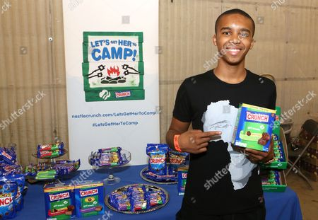 Actor Donis Leonard Jr. supports the #LetsGetHerToCamp campaign with Nestle Crunch Girl Scout Candy Bars at a Teen Choice Awards gift suite on in Los Angeles. To help send girls to Girl Scout camp visit NestleCrunch.com/LetsGetHerToCamp by August 31