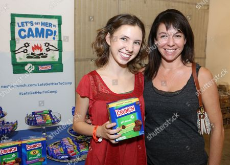 Stock Photo of Actress Autumn Wendel, left, supports the #LetsGetHerToCamp campaign with Nestl? Crunch Girl Scout Candy Bars at a Teen Choice Awards gift suite on in Los Angeles. To help send girls to Girl Scout camp visit NestleCrunch.com/LetsGetHerToCamp by August 31