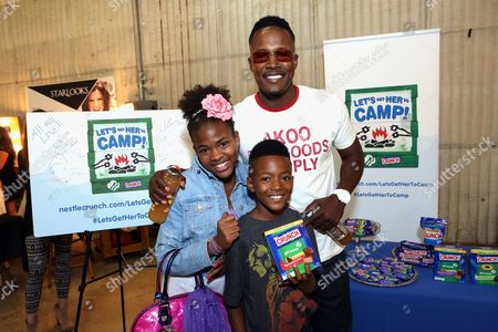 Actor Flex Alexander, right, supports the #LetsGetHerToCamp campaign with Nestle Crunch Girl Scout Candy Bars at a Teen Choice Awards gift suite on in Los Angeles. To help send girls to Girl Scout camp visit NestleCrunch.com/LetsGetHerToCamp by August 31