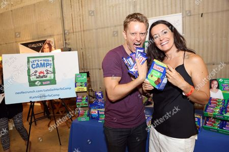 Actors Neil Jackson and TV personality Kylie Furneaux support the #LetsGetHerToCamp campaign with Nestl? Crunch Girl Scout Candy Bars at a Teen Choice Awards gift suite on in Los Angeles. To help send girls to Girl Scout camp visit NestleCrunch.com/LetsGetHerToCamp by August 31