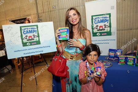 Actress Sandra Vidal, left, supports the #LetsGetHerToCamp campaign with Nestle Crunch Girl Scout Candy Bars at a Teen Choice Awards gift suite on in Los Angeles. To help send girls to Girl Scout camp visit NestleCrunch.com/LetsGetHerToCamp by August 31