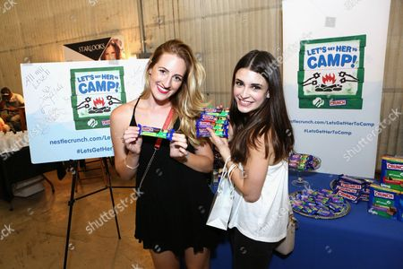 Actress Daniela Bobadilla, right, supports the #LetsGetHerToCamp campaign with Nestl? Crunch Girl Scout Candy Bars at a Teen Choice Awards gift suite on in Los Angeles. To help send girls to Girl Scout camp visit NestleCrunch.com/LetsGetHerToCamp by August 31