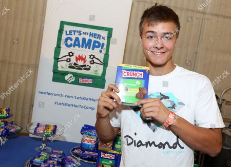 Actor Peyton Meyer supports the #LetsGetHerToCamp campaign with Nestl? Crunch Girl Scout Candy Bars at a Teen Choice Awards gift suite on in Los Angeles. To help send girls to Girl Scout camp visit NestleCrunch.com/LetsGetHerToCamp by August 31