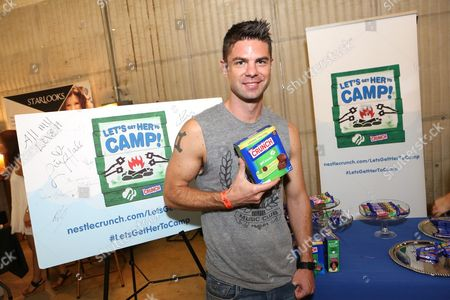 Stock Image of Actor Sterling Jones supports the #LetsGetHerToCamp campaign with Nestle Crunch Girl Scout Candy Bars at a Teen Choice Awards gift suite on in Los Angeles. To help send girls to Girl Scout camp visit NestleCrunch.com/LetsGetHerToCamp by August 31