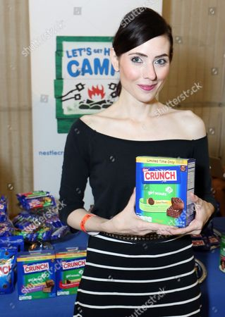 Actress Adrienne Wilkinson supports the #LetsGetHerToCamp campaign with Nestle Crunch Girl Scout Candy Bars at a Teen Choice Awards gift suite on in Los Angeles. To help send girls to Girl Scout camp visit NestleCrunch.com/LetsGetHerToCamp by August 31