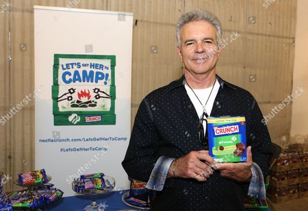 Actor Tony Denison supports the #LetsGetHerToCamp campaign with Nestle Crunch Girl Scout Candy Bars at a Teen Choice Awards gift suite on in Los Angeles. To help send girls to Girl Scout camp visit NestleCrunch.com/LetsGetHerToCamp by August 31