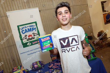 Sam Pottorff supports the #LetsGetHerToCamp campaign with Nestle Crunch Girl Scout Candy Bars at a Teen Choice Awards gift suite on in Los Angeles. To help send girls to Girl Scout camp visit NestleCrunch.com/LetsGetHerToCamp by August 31