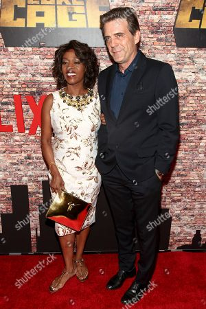 """Alfre Woodard, left, and Roderick Spencer, right, attend the Netflix's original series premiere of Marvel's """"Luke Cage"""" at the AMC Magic Johnson Harlem 9 Theater, in New York"""