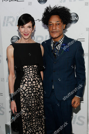 """Amy Fine Collins, left, and Ike Ude, right, attend the premiere of """"Iris"""" at the Paris Theatre, in New York"""
