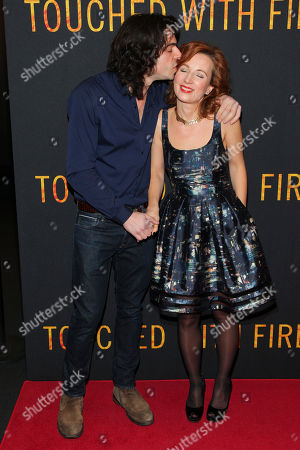 "Paul Dalio, left, and Kristina Nikolova, right, attend the premiere of ""Touched With Fire"" at the Walter Reade Theatre, in New York"
