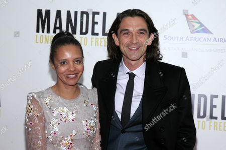 """Director Justin Chadwick, right, and his wife Michelle Chadwick, left, attend the New York premiere of """"Mandela: Long Walk To Freedom"""" on in New York"""