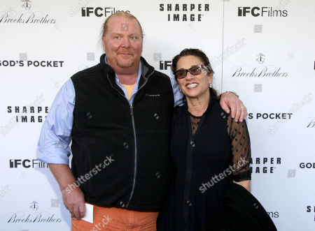 """Stock Photo of Restauranteur Mario Batali, left, and his wife Susi Cahn, right, attend a screening of """"God's Pocket"""", in New York"""