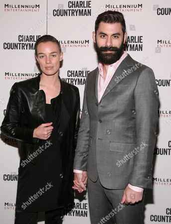 """Fashion model Elliot Sailors, left, and Adam Santos-Coy, right, attend a screening of """"Charlie Countryman"""" on in New York"""