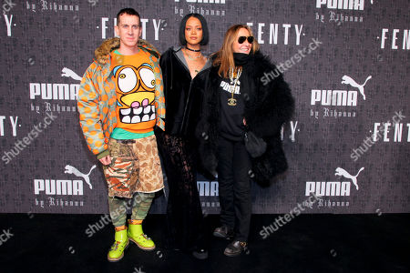 Jeremy Scott, from left, Rihanna and Carlyne Cerf de Dudzeele attend the FENTY PUMA by Rihanna fashion show at 23 Wall Street, in New York