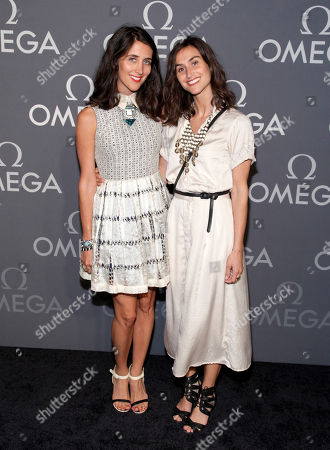 Fashion designers Jodie Snyder, left, and Danielle Snyder, right, attend the Omega Speedmaster Dark Side of the Moon launch event, in New York
