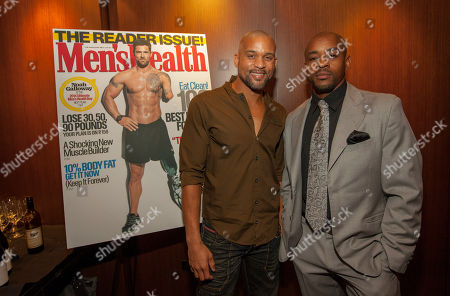 Celebrity fitness trainer Shaun T and former Chicago Bear Rashied Davis during the pre-race dinner for the 9th annual Men's Health Urbanathlon presented by Polo Red by Ralph Lauren, at RPM Steak on in Chicago