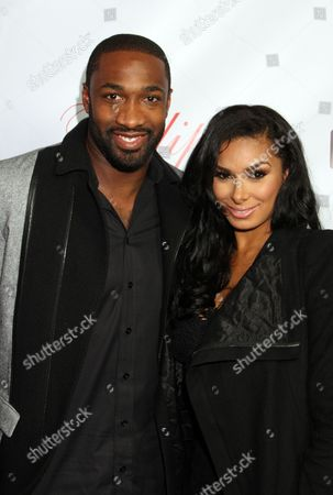 Gilbert Arenas and Laura Govan attend the Game's Private Black Friday Birthday Dinner for The Game at Philippe on in Beverly Hills, California
