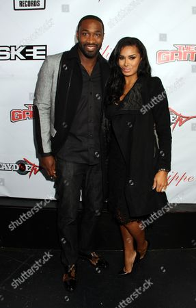 Stock Image of Gilbert Arenas and Laura Govan attend the Game's Private Black Friday Birthday Dinner for The Game at Philippe on in Beverly Hills, California