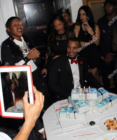 """Singer-songwriter Stacy Barthe (L) signs """"happy birthday"""" to Jayceon Taylor (C) aka The Game at his Private Black Friday Birthday Dinner at Philippe on in Beverly Hills, California"""