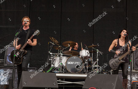 Shimon Moore, Mark Goodwin and Emma Anzai of Sick Puppies perform at Rock on the Range on in Columbus, Ohio