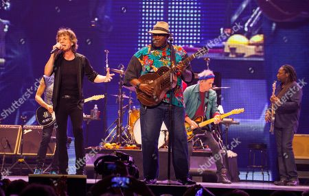 Mick Jagger of the Rolling Stones, special guest Taj Mahal with Keith Richards and Darryl Jones of the Rolling Stones perform at the United Center on in Chicago
