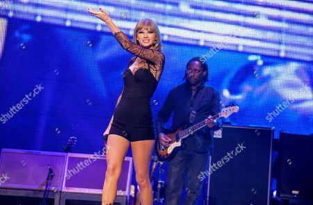 Special guest Taylor Swift and Darryl Jones perform with the Rolling Stones at the United Center on in Chicago