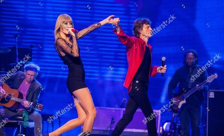 Keith Richards of the Rolling Stones, special guest Taylor Swift with Mick Jagger and Darryl Jones of the Rolling Stones perform at the United Center on in Chicago